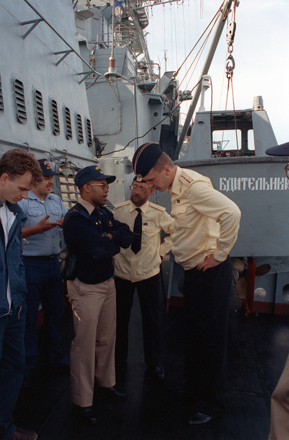 Midshipman 1ST Class Michael Nelms serves as an interpreter for USS DEYO (DD-989) sailors visiting the Russian navy Krivak I class frigate BDITELNY as part of an exchange of observers and crewmen during exercise BALTOPS '93. For the first time in the 22-year history of BALTOPS, the Eastern European countries of Estonia, Latvia, Lithuania, Poland and Russia were invited to participate in the non-military phases of the exercise. DEYO is serving as flagship for the exercise commander