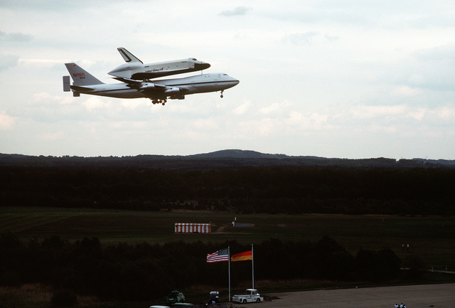 NASA 747 Shuttle Carrier Aircraft (SCA) with Space Shuttle Enterprise, OV-101, attached comes in for a landing at Koln Airport during a tour of Europe which included a stop at the Paris Air Show. Exact Date Shot Unknown