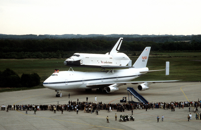 NASA 747 Shuttle Carrier Aircraft (SCA) with Space Shuttle Enterprise, OV-101, is greeted by a crowd at Koln Airport during a tour of Europe which included a stop at the Paris Air Show. Exact Date Shot Unknown