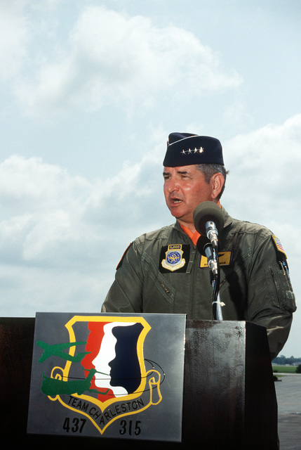 Air Mobility Command's Commander, GEN Ronald Fogelman, at the lectern during the turnover ceremonies for the first C-17 Globemaster III being delivered to the Air Force