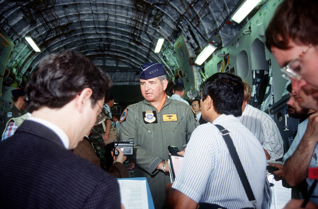 Air Mobility Command's Commander, GEN Ronald Fogelman, talks to the press from the cargo loading ramp after turnover ceremonies for the first C-17 Globemaster III delivered to the Air Force