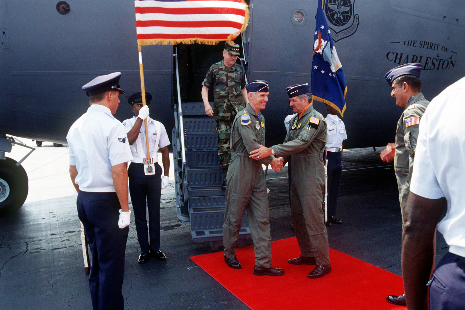GEN Merill McPeak, Air Force CHIEF of STAFF, is greeted by Air Mobility Command's Commander, GEN Ronald Fogelman on his arrival after he piloted in the first C-17 Globemaster III being delivered to the Air Force. On the right is Commander of the 437th Airlift Wing, BGEN Thomas R. Mikolajcik waits to greet GEN McPeak