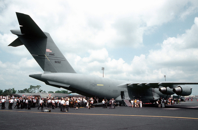 The first C-17 Globemaster III delivered to the Air Force's 437th Airlift Wing sits on the ramp after turnover ceremonies. VIPs, Press, Air Force personnel and families tour the latest addition to the United States' airlift force