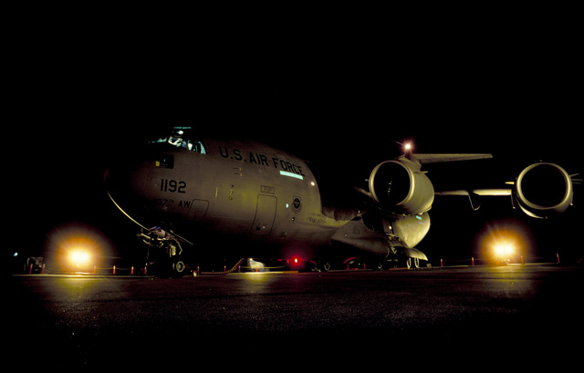 The first C-17 Globemaster III delivered to the Air Force's Air Mobility Command's 437th Airlift Wing, lighted by maintenance lights, sits on the ramp at Charleston AFB, South Carolina. Exact Date Shot Unknown