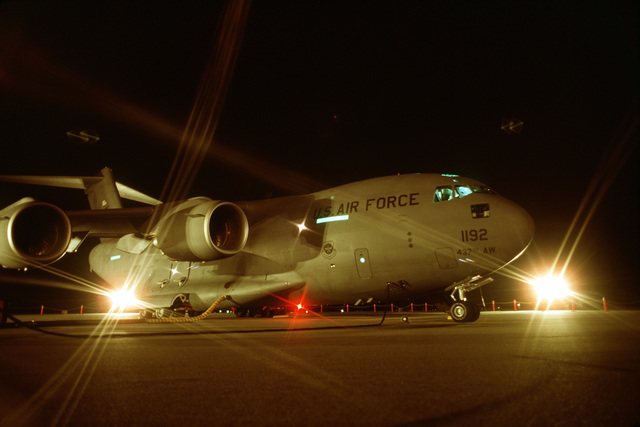 "Nighttime view with maintenance lights shining on the first C-17 Globemaster III, in the Air Force inventory. It was designated ""The Spirit of Charleston"" and was turned over to the Air Force's 437th Airlift Wing on 14 Jun 93"