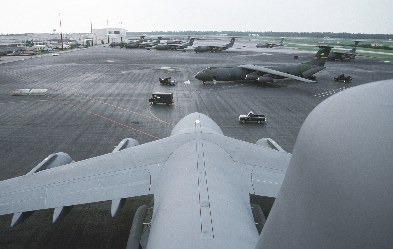 View from atop the vertical stabilizer of the first C-17 Globemaster III, in the Air Force inventory, showing the flightline and numerous C-141B Starlifters assigned to the 437th Airlift Wing