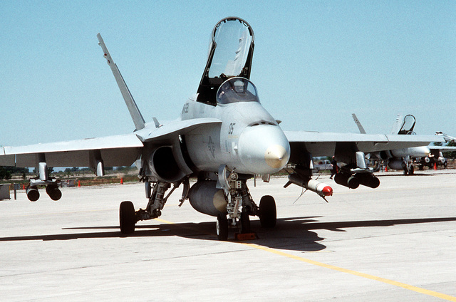 A front view of a Marine Fighter Attack Squadron 321 (VMFA-321) F/A-18A Hornet aircraft armed with four LAU-68 2.75-inch rocket pods and a CATM-88 HARM captive air training missile. The reserve squadron is at Fallon for two weeks of active duty training at the Naval Air Warfare Center target complex