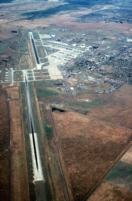 An aerial view of the base, looking west of the Air Combat Command's C-5B Galaxy and C-141B Starlifter aircraft facilities