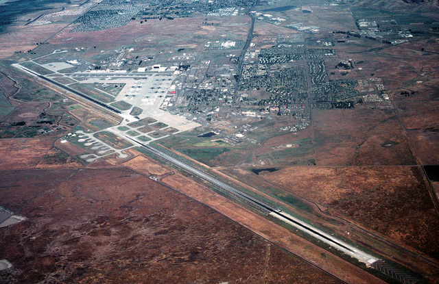 An aerial view of the base, looking west/northwest of the Air Combat Command's C-5B Galaxy and C-141B Starlifter aircraft facilities