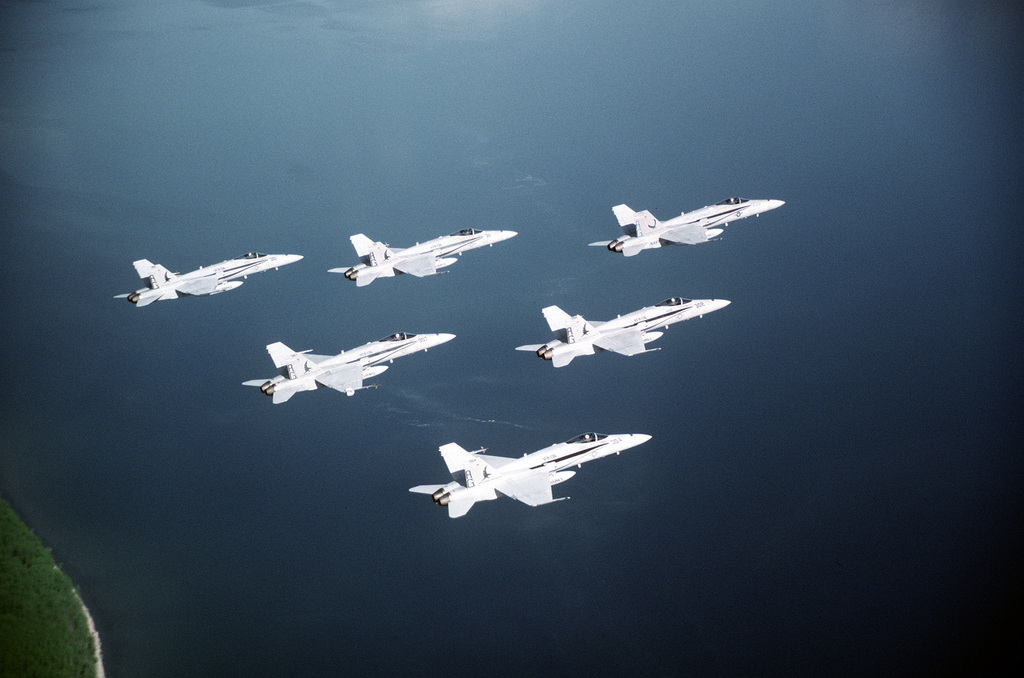 An air-to-air right side view of six Strike Fighter Squadron 136 (VFA-136) F/A-18C Hornet aircraft in a delta formation. VFA-136 is embarked aboard the nuclear-powered aircraft carrier USS GEORGE WASHINGTON (CVN-73)
