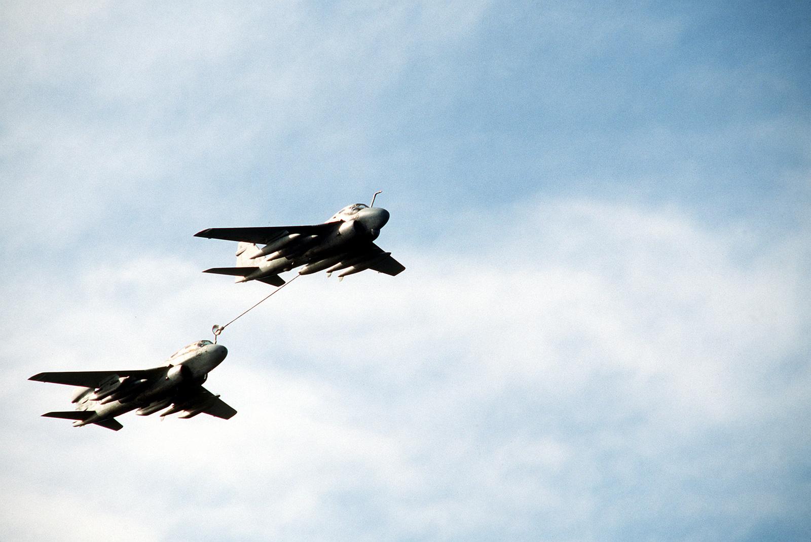 An KA-6E Intruder aircraft of Attack Squadron 95 (VA-95), the Green Lizards, is shown refueling an EA-6B Prowler aircraft of Tactical Warfare Squadron 135 (VAQ-135), the Black Ravens, during a fire power demonstration near the nuclear-powered aircraft carrier USS ABRAHAM LINCOLN (CVN-72) (not shown)