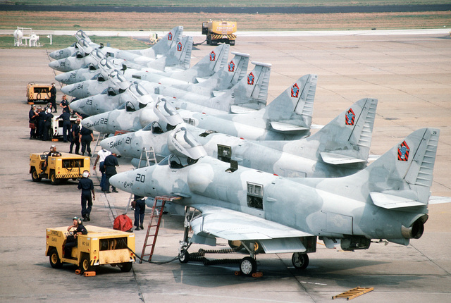 Ground crew members use NC-8A mobile powerplants to service A-4f Skyhawk aircraft of Fighter Squadron 43 (VF-43) as the planes are parked in formation on the flight line. The Skyhawks are scheduled for retirement from service on October 1ST