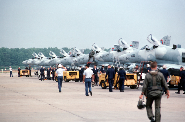 Ground crew members use NC-8A mobile powerplants to service A-4F Skyhawk aircraft of Fighter Squadron 43 (VF-43) as the aircraft are parked in formation on the flight line. The Skyhawks are scheduled for retirement from service on October 1ST