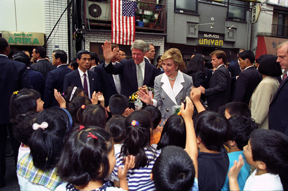 President William J. Clinton and First Lady Hillary Rodham Clinton Visit with School Children in the Okuma Shopping District in Japan