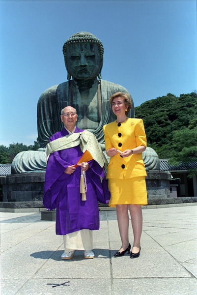 Photograph of First Lady Hillary Rodham Clinton and an Unidentified Man Standing in Front of The Great Buddha in Kamakura, Japan.