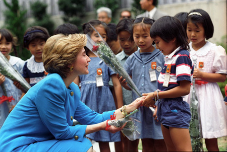 Photograph of First Lady Hillary Rodham Clinton Visiting the Meguro Incineration Plant in Tokyo, Japan