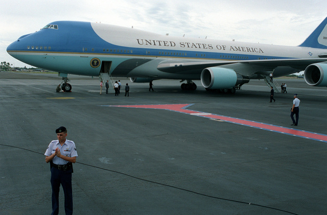 Air Force One, a VC-25A aircraft, stands on the runway as President William Jefferson Clinton and Hillary Rodham Clinton prepare to debark from the plane. The Clintons, along with Secretary of Defense Les Aspin, will be touring area military installations during their three-day stay