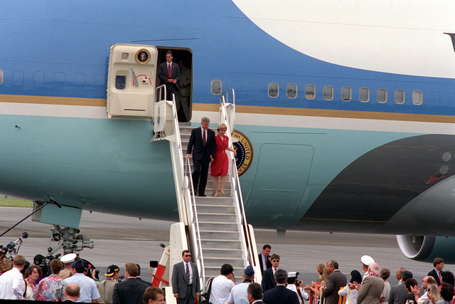 President William Jefferson Clinton and Hillary Rodham Clinton debark from Air Force One, a VC-25A aircraft, upon their arrival in Hawaii. The Clintons, along with Secretary of Defense Les Aspin, will be touring area military installations during their three-day stay