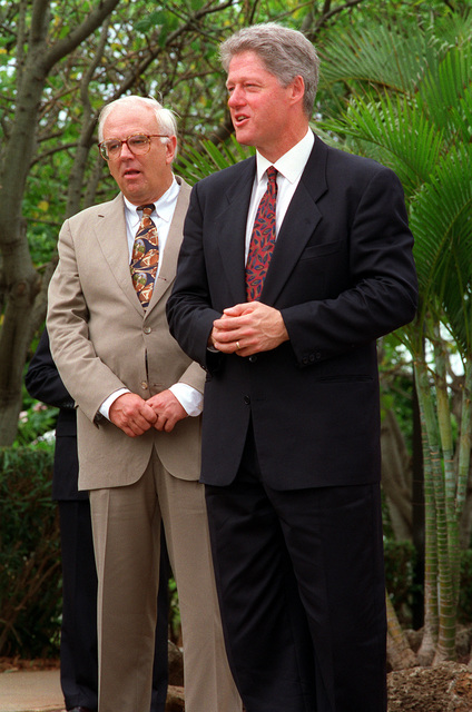 President William Jefferson Clinton and Secretary of Defense Les Aspin stand at Admiral's Landing as they prepare to visit the ARIZONA (BB-39) Memorial. The two men are in Hawaii to tour area military installations