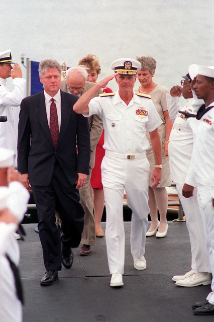 The presidential party arrives to tour the ARIZONA (BB-39) Memorial. President William Jefferson Clinton and Adm. Charles R. Larson, commander-in-chief, U.S. Pacific Fleet, are followed by Secretary of Defense Les Aspin, HIllary Rodham Clinton and Mrs. Aspin. Clinton is in Hawaii to tour area military installations