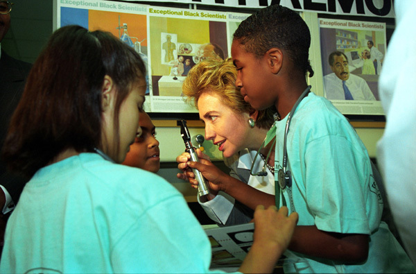 Photograph of First Lady Hillary Rodham Clinton Visiting with Children in the Saturday Science Academy at the Charles R. Drew University of Medicine and Science
