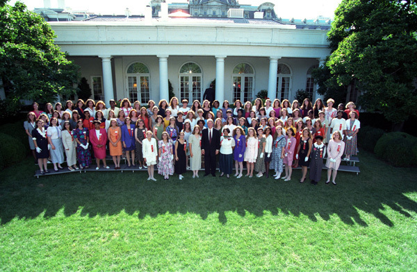 Photograph of President William J. Clinton with a Girls Nation Group in the Rose Garden at the White House