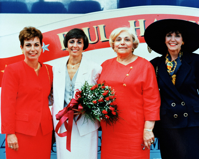 The christening party poses for a photograph following the christening and launch of the guided missile destroyer PAUL HAMILTON (DDG-60) at Bath Iron Works shipyard. They include, from left: Mrs. Frank E. Underhill, matron of honor; Mrs. Barbara S. Pope, ship's sponsor; Mrs. Gus A. Apyridon, matron of honor; and Mrs. William B. Ten Eyck, matron of honor