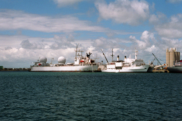 A port view of the missile range instrumentation ship USNS REDSTONE (T-AGM-20), left, and a starboard view of the acoustic research ship USNS HAYES (T-AG-195) while both ships are in port