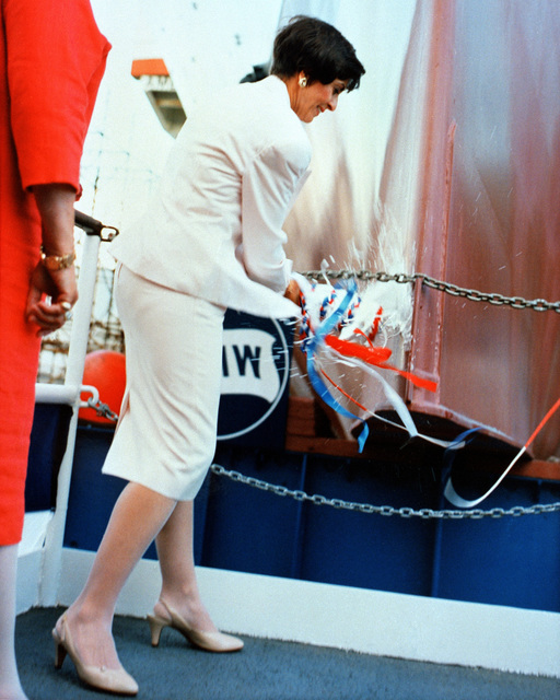 Mrs. Barbara Pope, ship's sponsor, breaks the traditional bottle of champagne on the bow of the guided missile destroyer PAUL HAMILTON (DDG-60) at the vessel's christening and launching ceremony