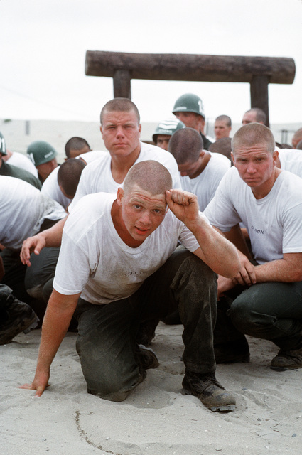 A group of Fourth phase Basic Underwater Demolition/SEAL (BUD/S) take a break before resuming their assault on the obstacle course at the Naval Special Warfare Center