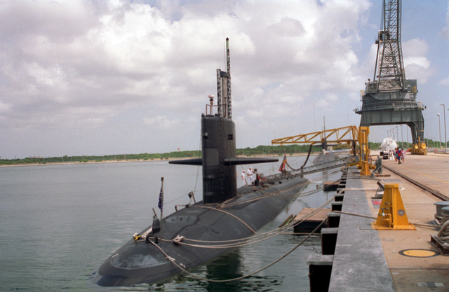 A port bow view of the nuclear-powered attack submarine USS L. MENDEL RIVERS (SSN-686) moored at a pier