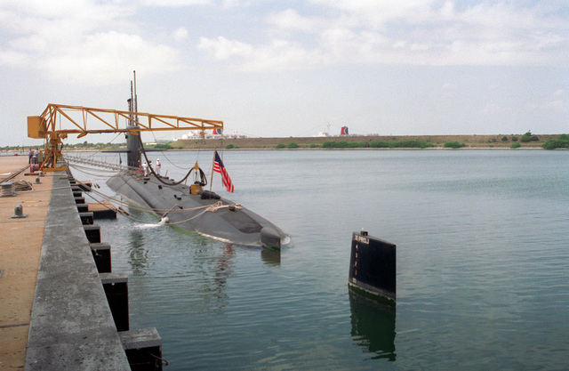A port quarter view of the nuclear-powered attack submarine USS L. MENDEL RIVERS (SSN-686) moored at a pier