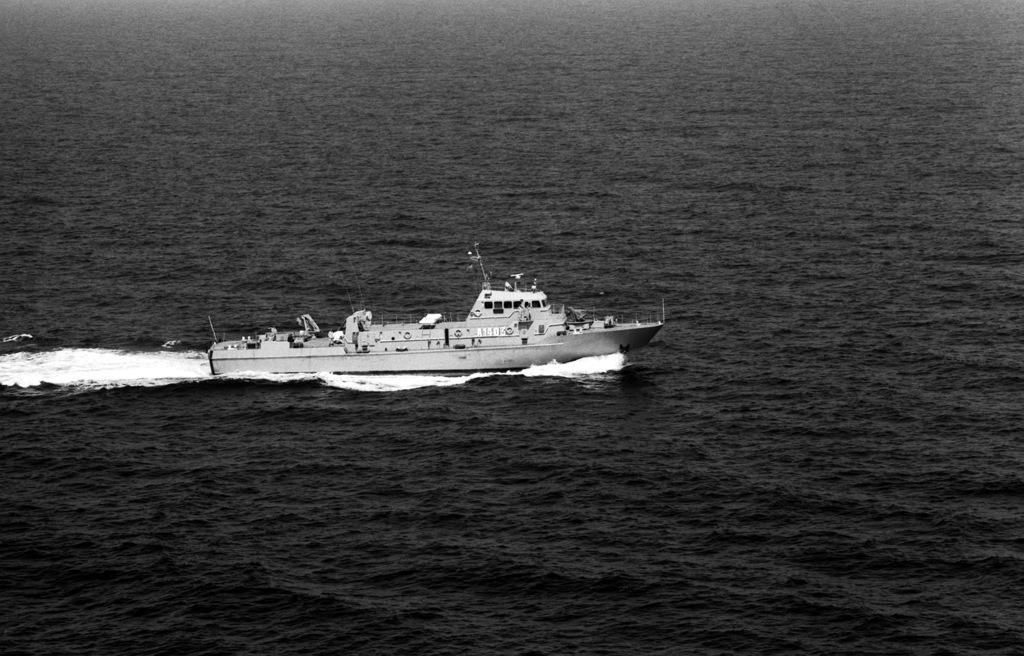 A starboard beam view of the Iranian Navy Hendijan class armed auxiliary A1403 underway