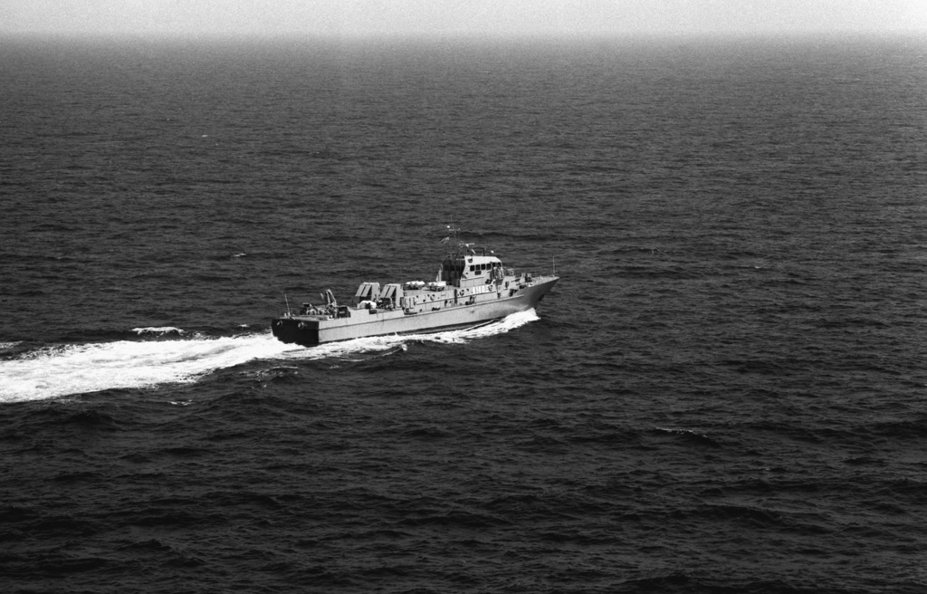 A starboard quarter view of the Iranian Navy Hendijan class armed auxiliary A1403 underway