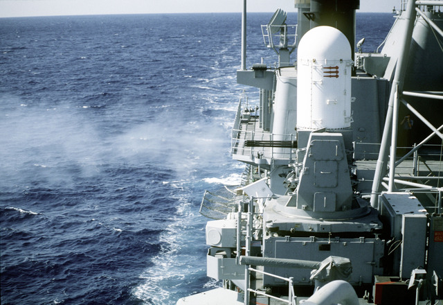 A view of the Mk-15 Close-In Weapons System (CIWS) (Phalanx Mount) firing on board the guided missile cruiser USS NORMANDY (CG-60). This weapon would be used in the event an enemy missile or aircraft got through any of the other defensive weapon systems on board the guided missile cruiser. The NORMANDY is currently deployed to the Adriatic Sea