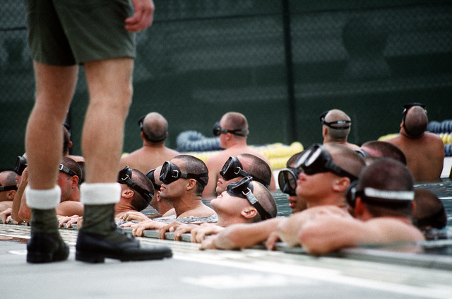 Basic Underwater Demolition/SEAL (BUD/S) students at the Naval Special Warfare Center must learn to breathe only through their mouths with their diving mask filled with water and their sinuses and eyes burning from chlorine as part of the First phase training