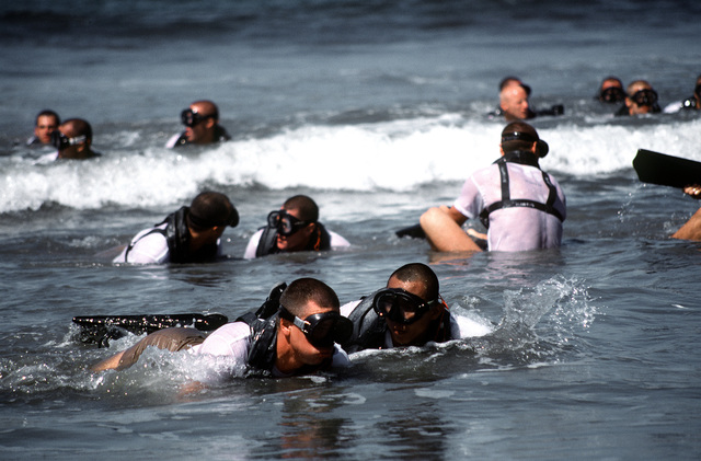 First phase Basic Underwater Demolition/SEAL (BUD/S) students swim out past the surf line, wait for a signal from their instructor, then return to the beach. This cycle continues until tired muscles scream for relief from icy water and pulling currents. Dive buddies are, and must be, inseparable while in the water