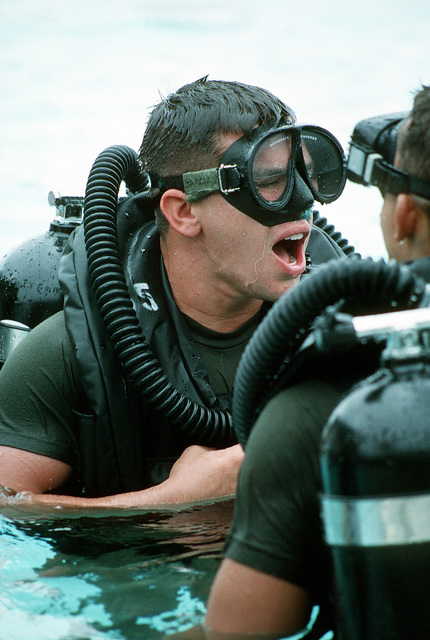 LT. Michael J. White, diving officer and instructor at the Special Warfare Center checks out a student in the Basic Underwater Demolition/SEAL (BUD/S) course before a training dive during the Second phase of SEAL team training