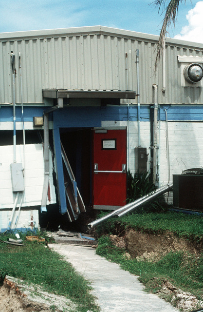 A close-up view of damage sustained by Trader Andy's Hut, a pierside bar and grill, during an earthquake that struck the region on August 8th