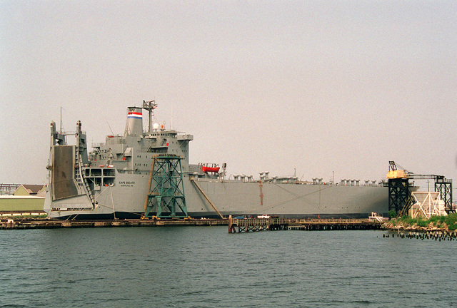 A starboard quarter view of the Military Sealift Command roll-on/roll-off vehicle cargo ship CAPE DUCATO (T-AKR-5051) moored in Baltimore Harbor. The ship is in Ready Reserve Force status