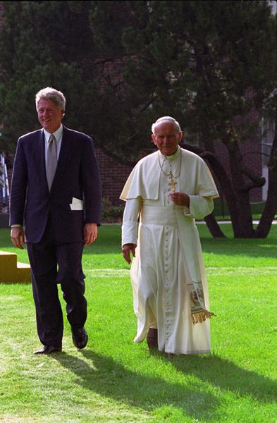 Photograph of President William J. Clinton and Pope John Paul II Walking through the Courtyard of Regis University in Denver, Colorado