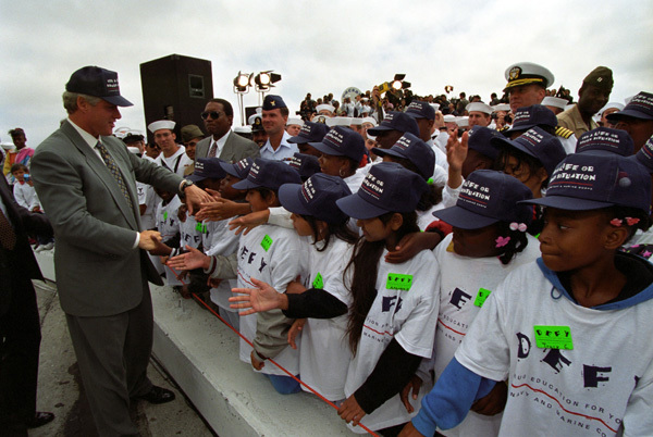Photograph of President William J. Clinton Greeting Young Supporters at the Alameda Naval Air Station