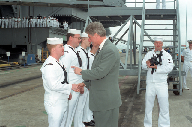 President William Jefferson Clinton converses with crew members aboard the nuclear-powered aircraft carrier USS CARL VINSON (CVN-70) duirng his visit to NAS, Alameda to discuss base closure issues