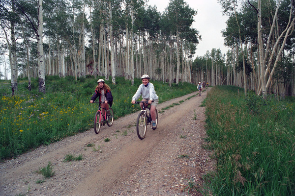Photograph of First Lady Hillary Rodham Clinton and Chelsea Clinton Bike Riding in Beaver Creek, Colorado
