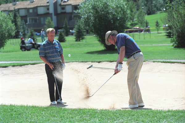 Photograph of President William J. Clinton Golfing with Jack Nicklaus at the Vail Golf Club in Vail, Colorado