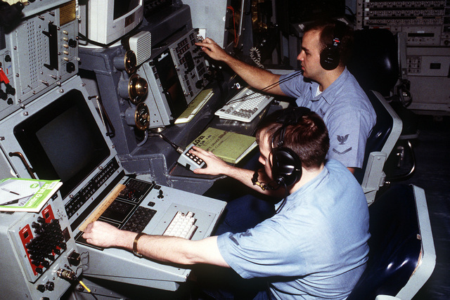 Fire control technician's monitor electronic warfare modules in the operations department on board the nuclear-powered aircraft carrier USS ABRAHAM LINCOLN (CVN-72) during WestPac '93