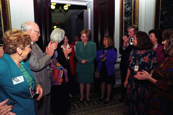 Photograph of First Lady Hillary Rodham Clinton Dropping by a Coffee Reception for White House Correspondence Volunteers