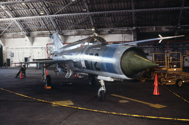 A front right side view of a Cuban MiG-21 fighter aircraft inside VF-45 hangar. It was flown to Key West on September 20, 1993 by a defecting Cuban pilot