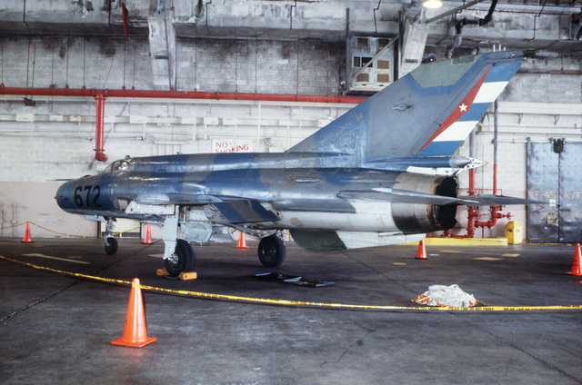 A left side view of a Cuban MIG-21 fighter aircraft inside VF-45 hangar. It was flown to Key West on September 20, 1993 by a defecting Cuban pilot