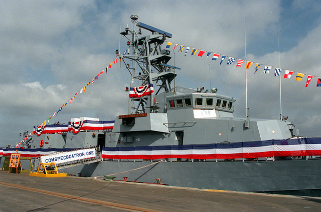 """A starboard bow view of the Cyclone class patrol craft USS HURRICANE (PC-3) tied up at Naval Air Station North Island for the formal commissioning ceremony of the ship as crew members """"Man the Rails"""". The HURRICANE has been assigned to Command Special Boat Squadron One based at the Coronado Amphibious Base"""